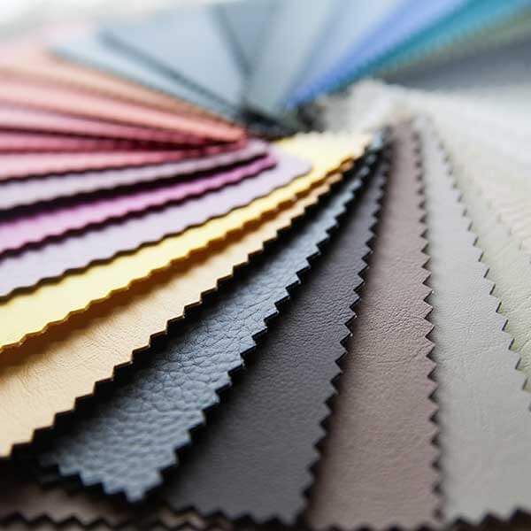 Color swatches fanned out with varying surface textures and colors.