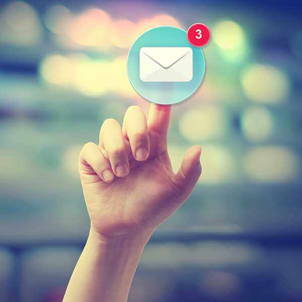 A hand reaching up and clicking on their mail icon showing three messages.